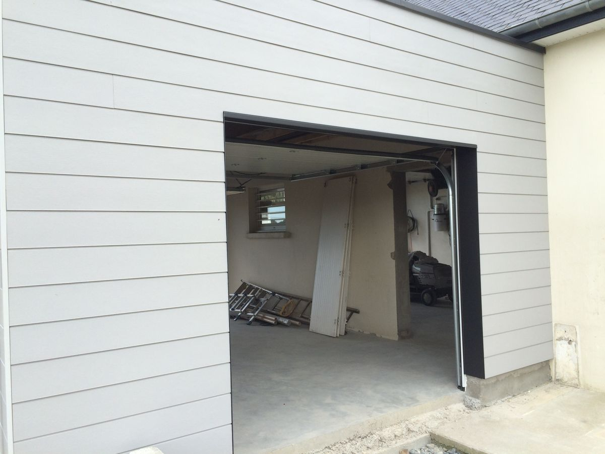 ralisation garage ossature bois les photos de la construction. Black Bedroom Furniture Sets. Home Design Ideas